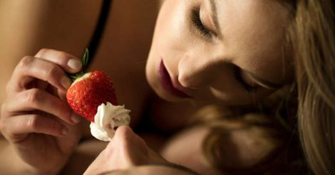 Foreplay with the use of strawberry