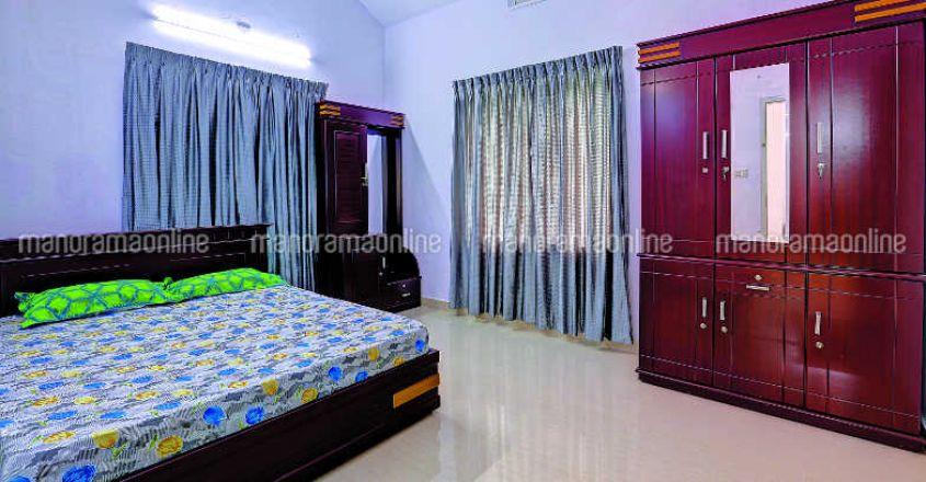 35-lakh-house-plan-angamali-bed
