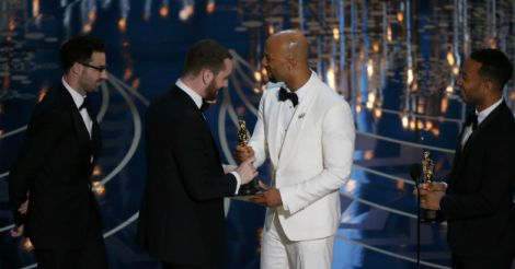 Singers John Legend (R) and Common (2nd R) present Sam Smith (2nd L) and Jimmy Napes