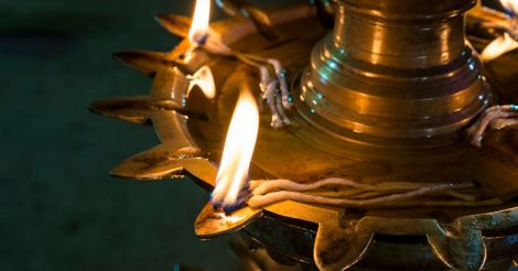 Oil lamp with burning flames during a ritual at Temple