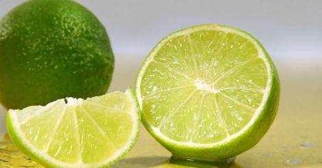 Freshly cut limes  with lime wedge with water droplets