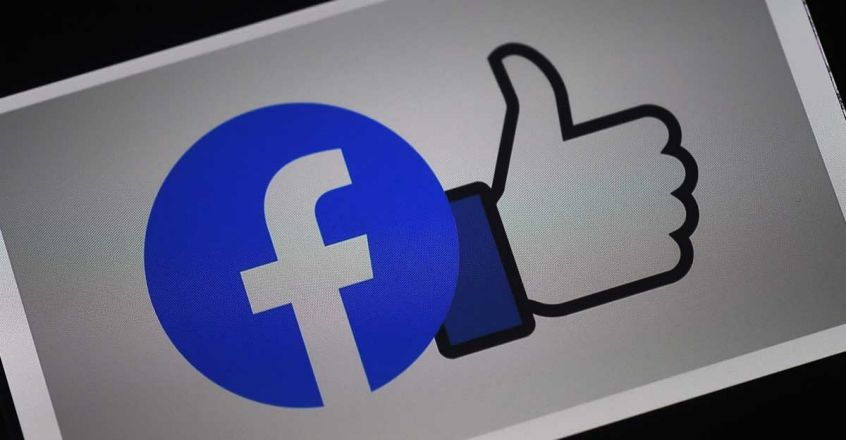 Facebook Logo (Photo by Olivier DOULIERY / AFP)