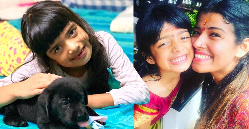 amritha-suresh-post-photos-of-daughter-avanthika-with-pet-dog