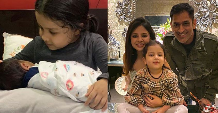 sakshi-dhoni-post-photos-of-daughter-ziva-holding-a-baby-viral