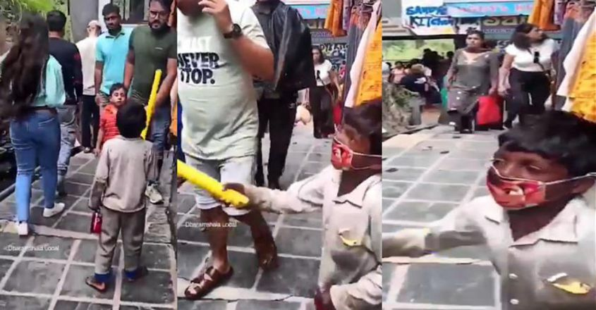 little-boy-scolds-people-for-not-wearing-masks-in-crowded-street-of-dharamshala
