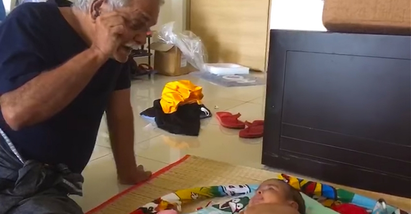 viral-video-of-a-grandfather-and-baby