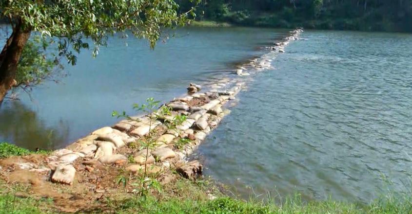 plastic sacks into this choking Payaswini river