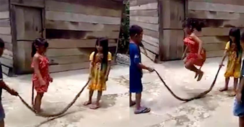 Children Cheerfully Skipping with Dead Snake in Vietnam