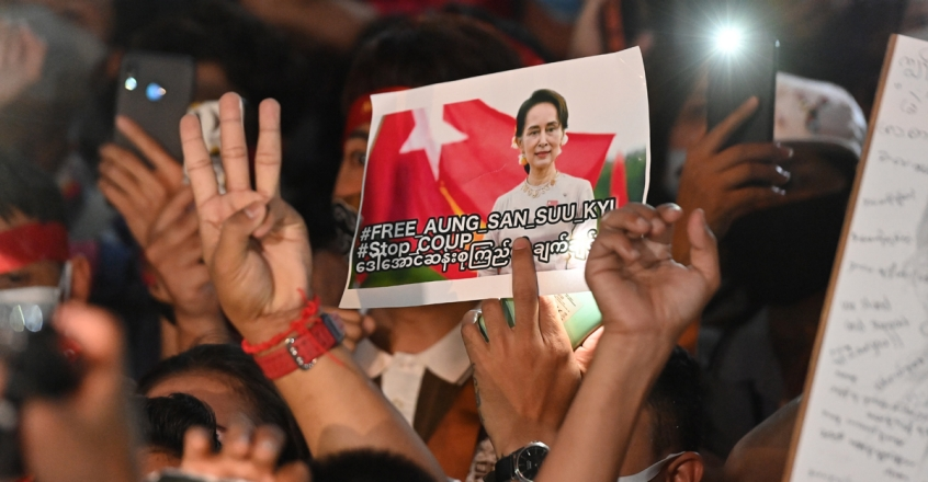 A-protester-holds-an-image-of-Aung-San-Suu-Kyi.-Photo-by-Mladen-ANTONOV-AFP