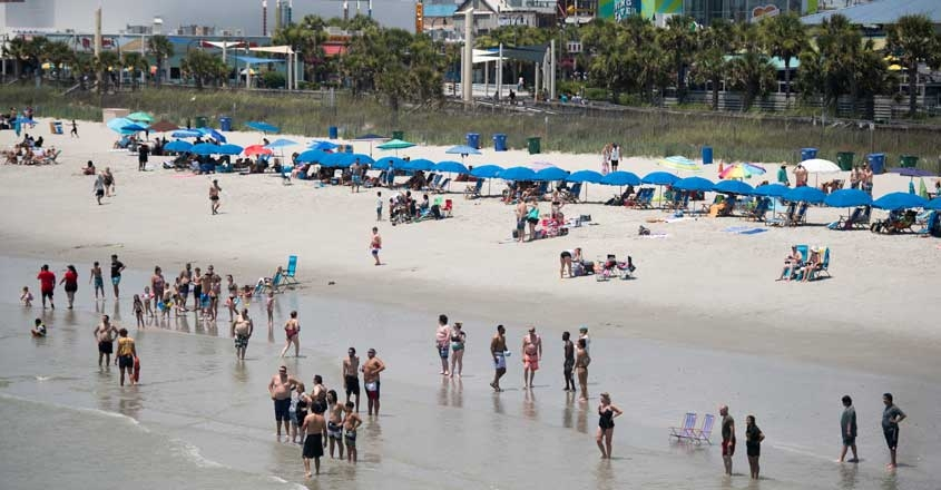 US-AMERICANS-CROWD-SOUTH-CAROLINA-BEACHES-ON-FOURTH-OF-JULY-WEEK