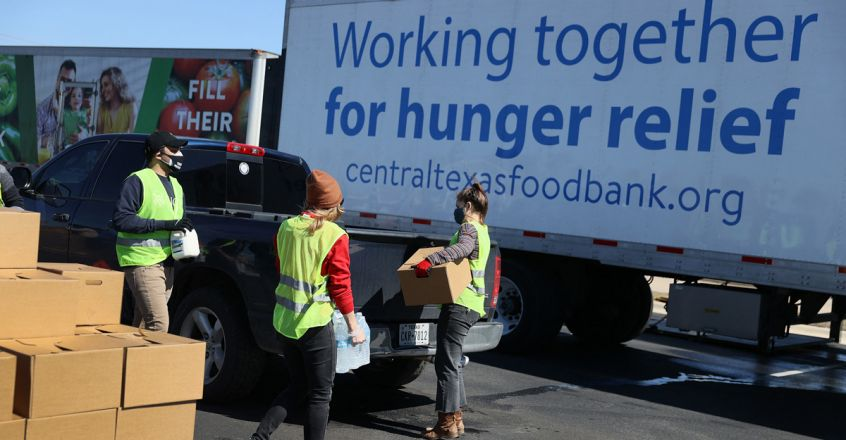 Volunteers with the Central Texas Food Bank. Photo by JOE RAEDLE / GETTY IMAGES NORTH AMERICA / AFP