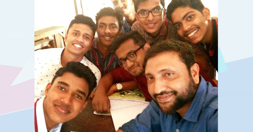 cyril-mathew-with-students