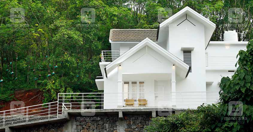 white-themed-house-manjeri-back