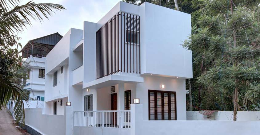 small-plot-house-changanacheri-view