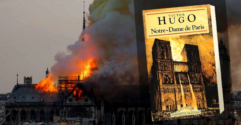 Smoke billows as flames burn through the roof of the Notre-Dame de Paris Cathedral