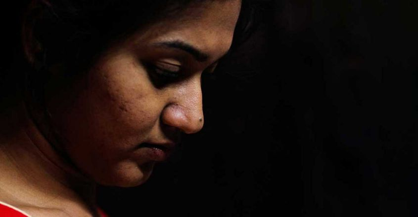 indian-female-staring-down-worry-depression