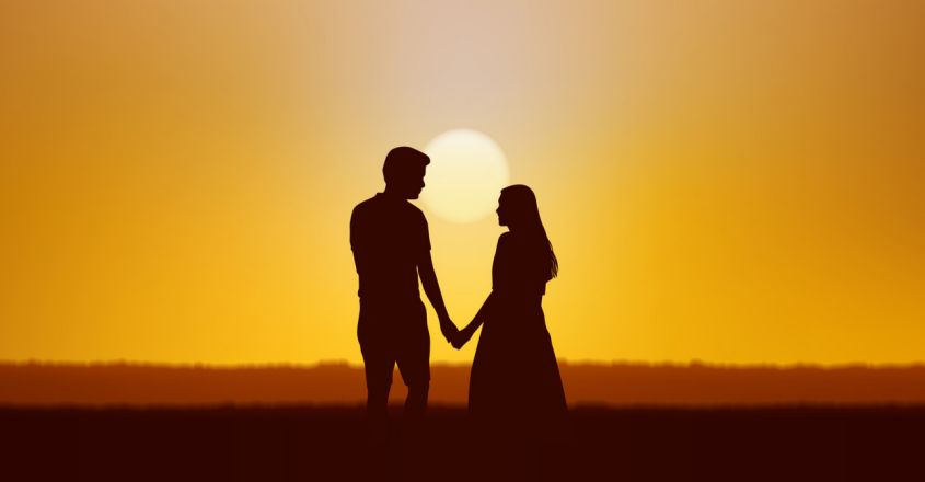 silhouette-couple-man-woman-holding-hand