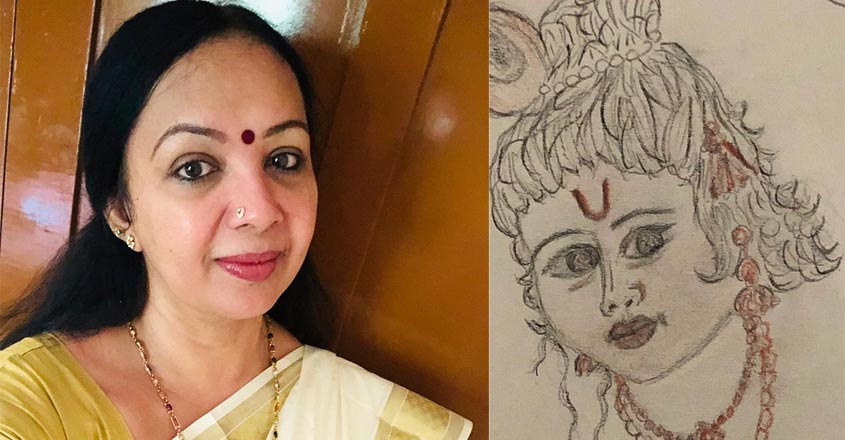 thara-kalyan-spend-time-by-drawing-picture
