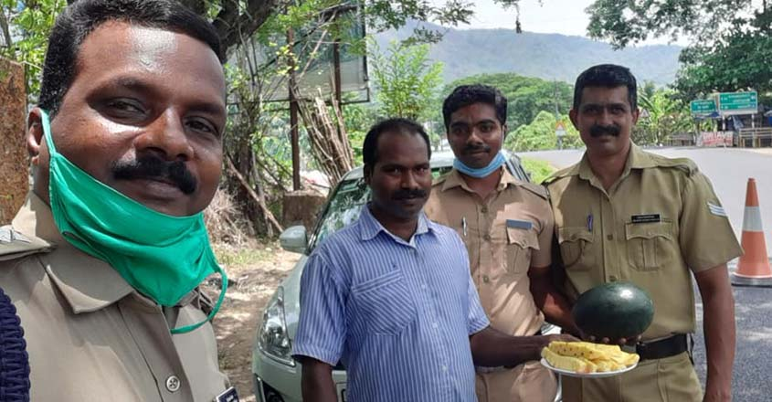 local-people-with-police-officers-on-duty-at-neriamangalam