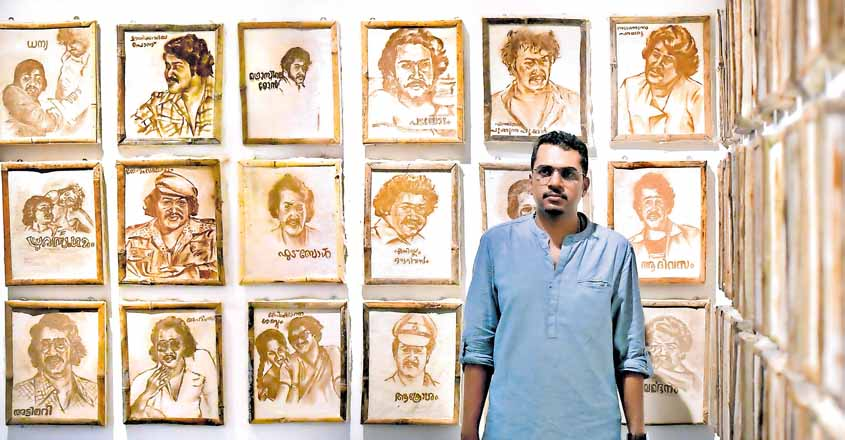 nikhil-varna-with-his-drawings-of-mohanlal