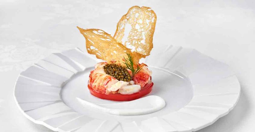Medallions of Chilled Lobster with Imperial Osetra Caviar  on a Raft of Garden Tomato with Horseradish Cream.jpg