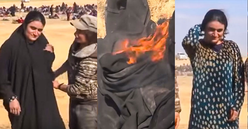 Yazidi sex slave sets fire to burqa she was forced to wear by the terror group